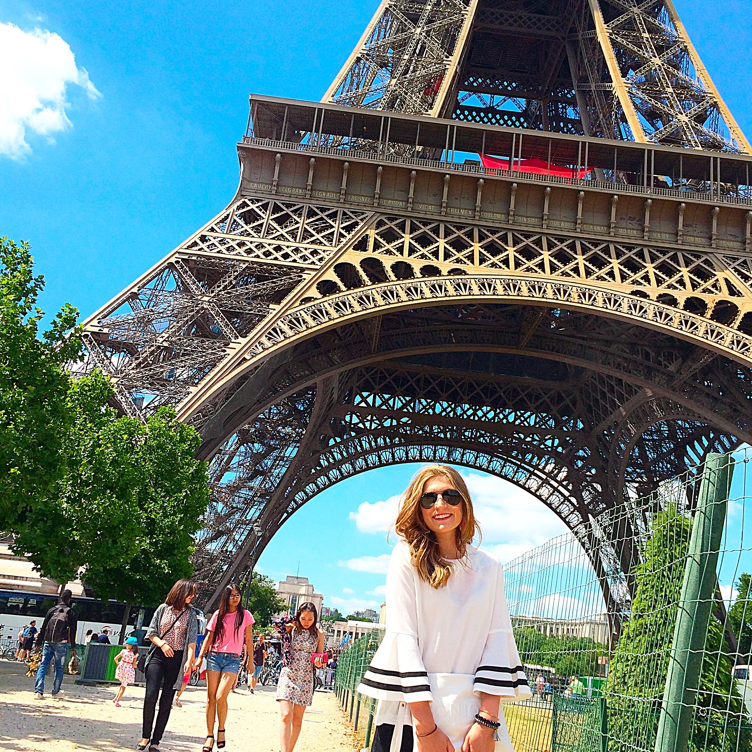 young girl in france at eiffel tower