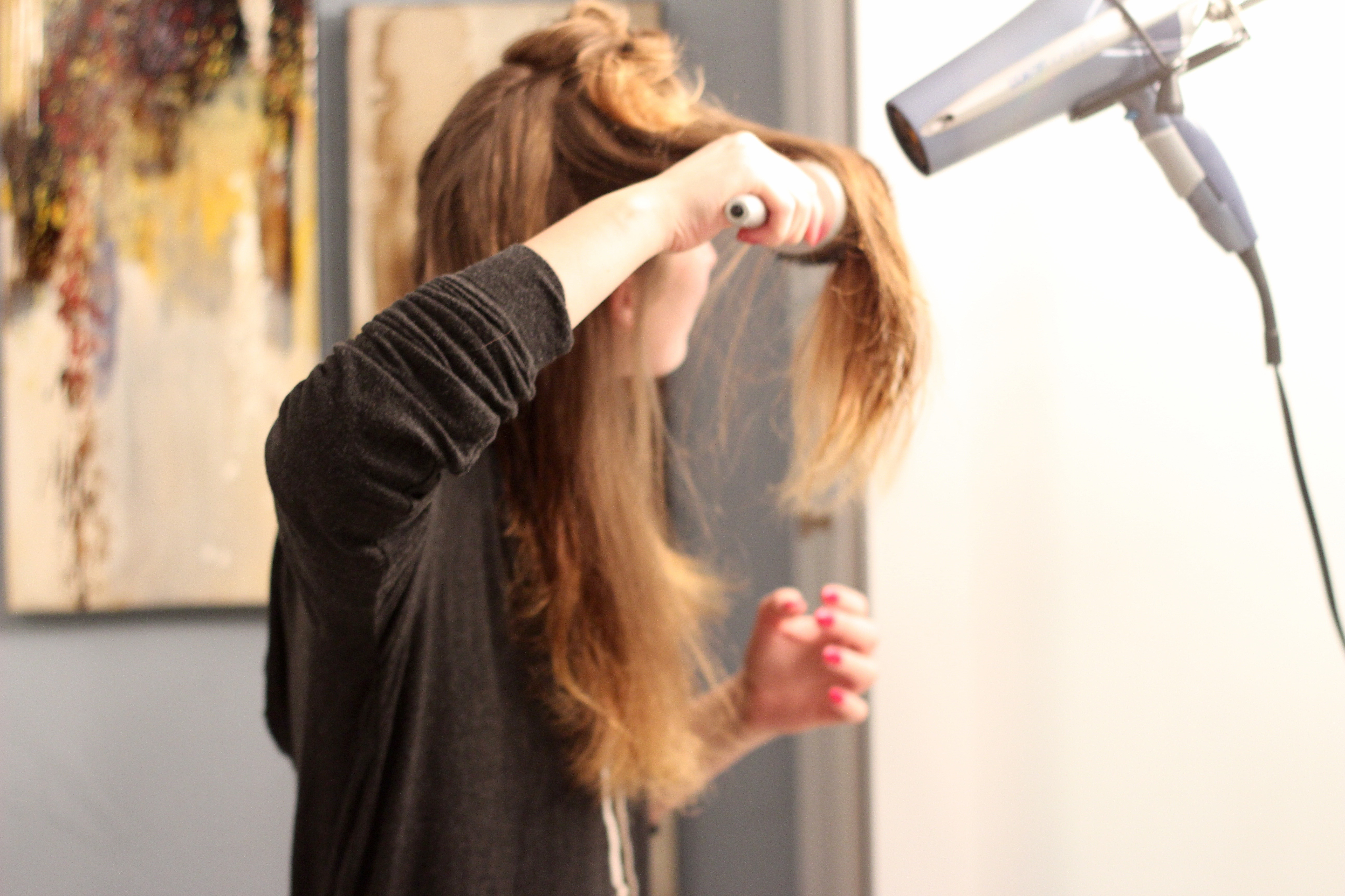 round brushing your hair with blo&go - Round Brush from Frizzy to Sleek Hair by popular Texas style blogger Audrey Madison Stowe