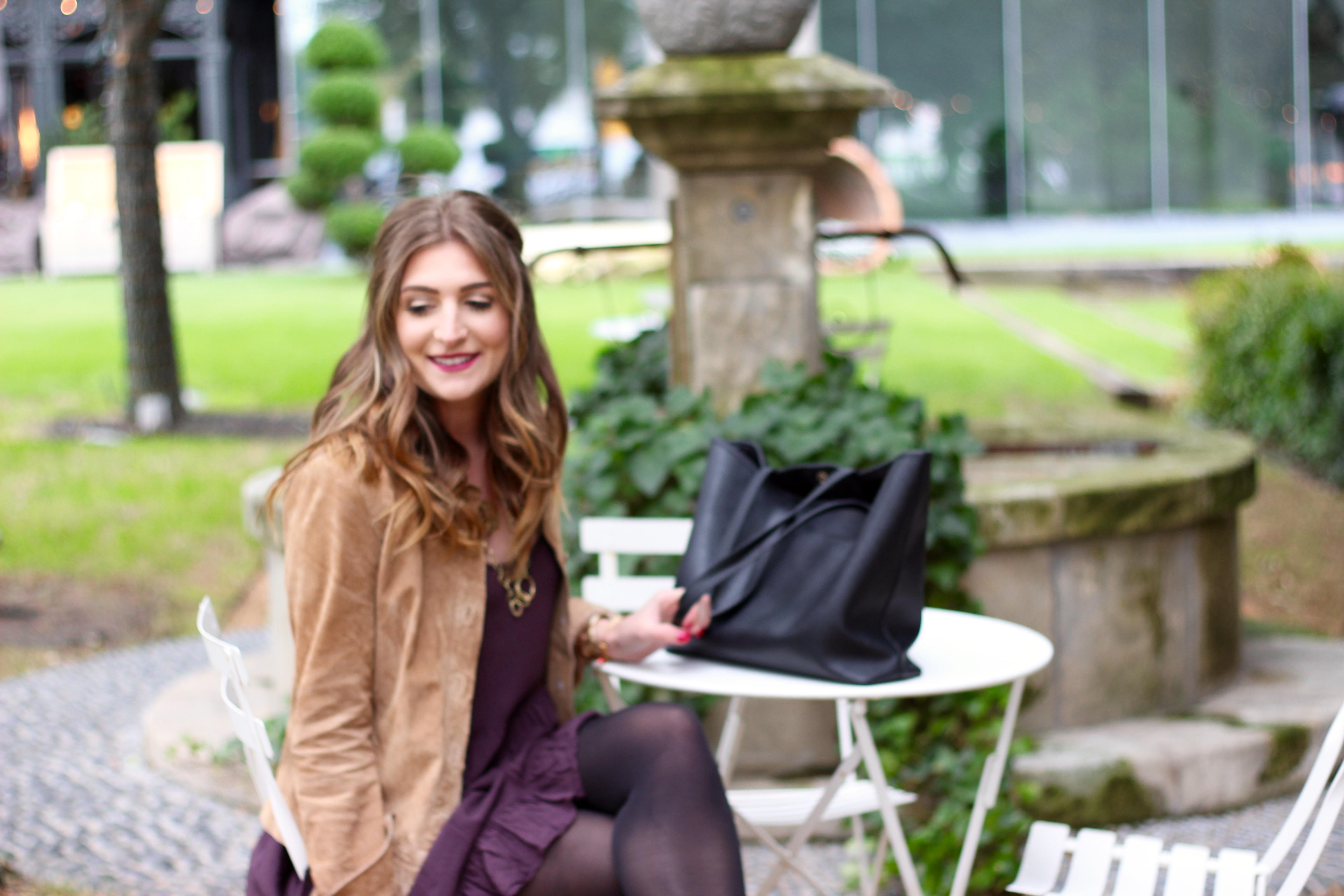 sitting in a courtyard in a flowy dress