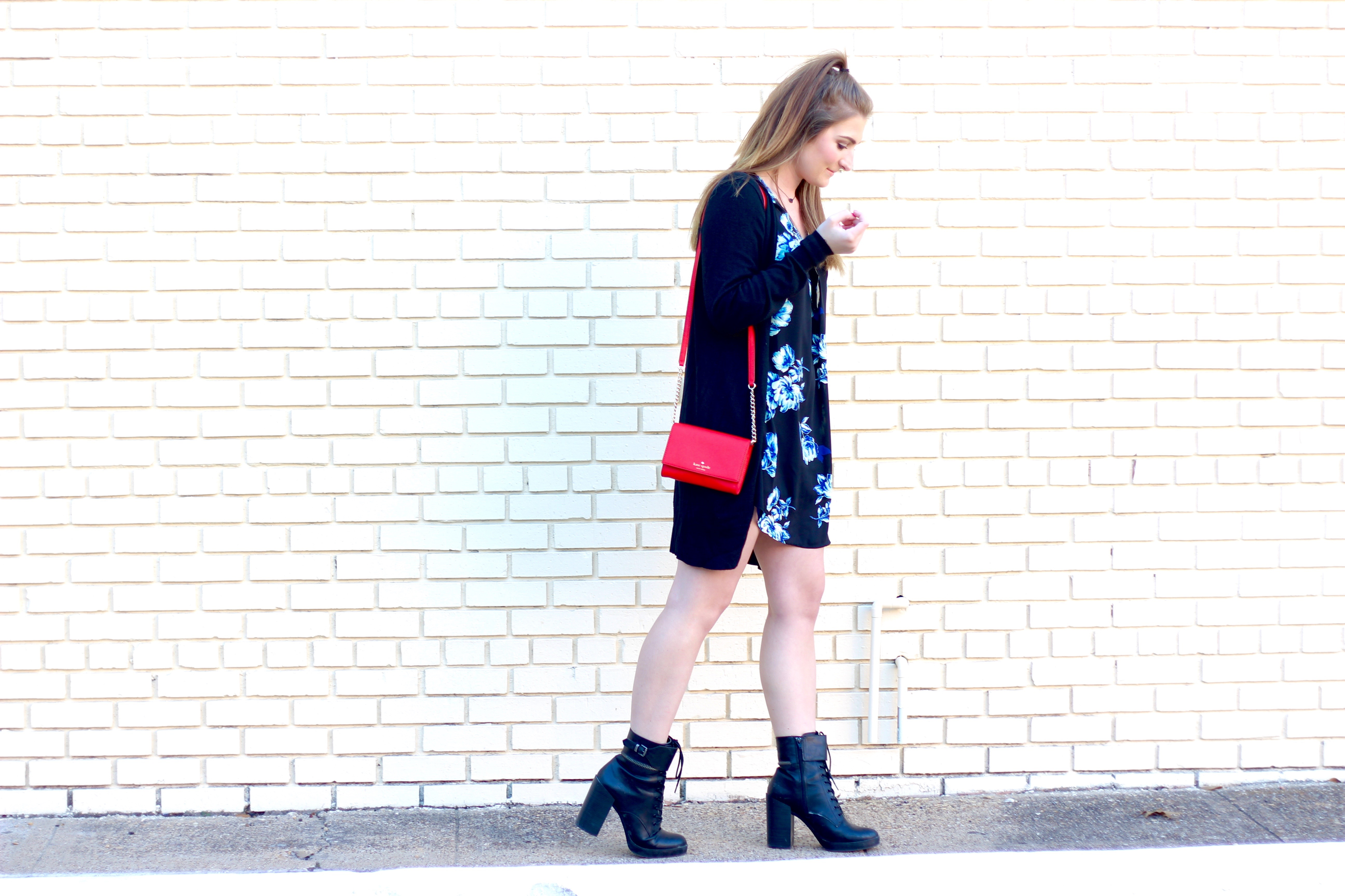 pop of red bag with black accessories