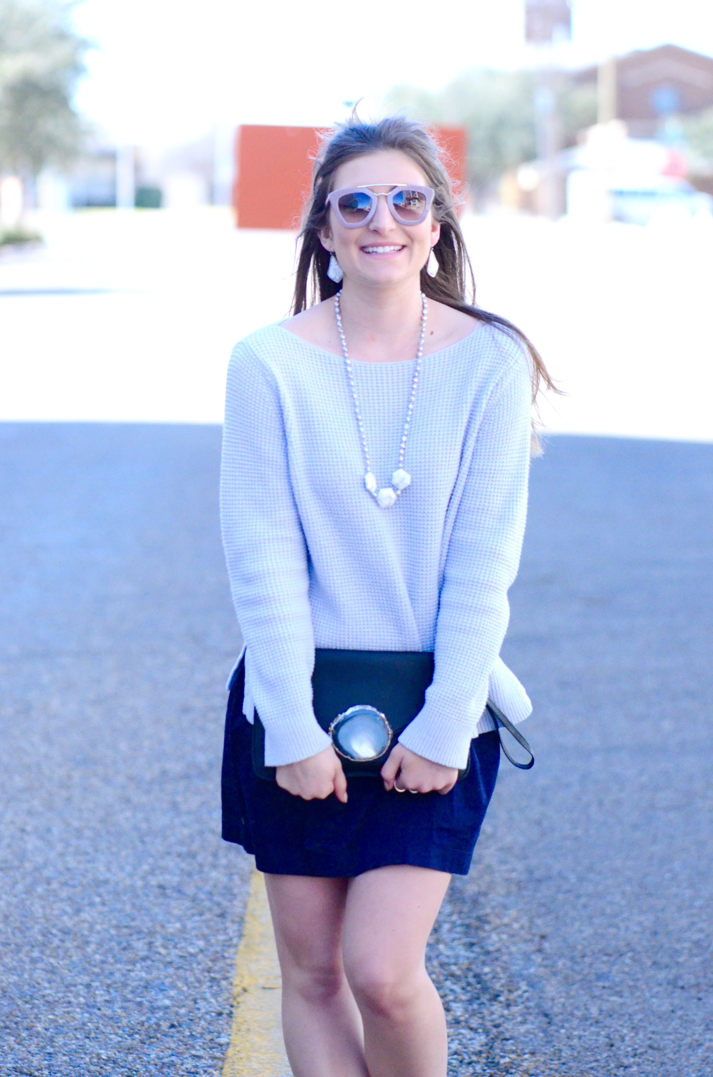 blue sweater and navy skirt