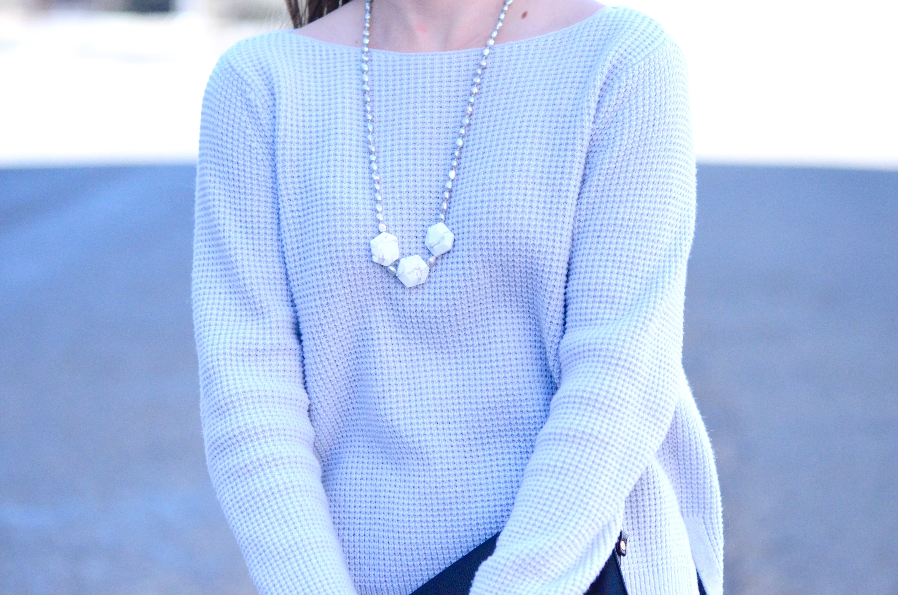 blue sweater with marble necklace