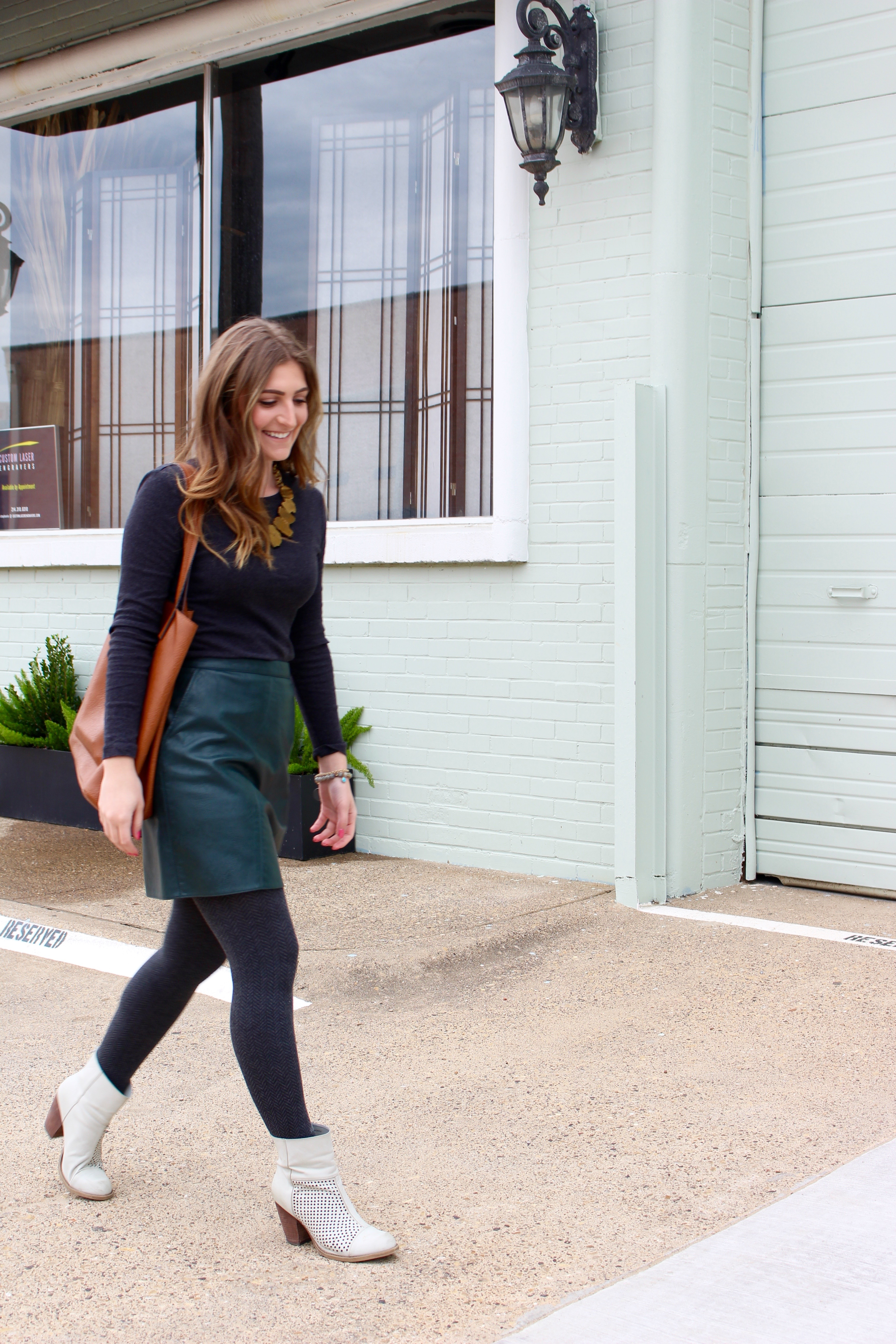 walking in dallas in a green leather skirt - Green Leather Skirt by popular Texas fashion blogger Audrey Madison Stowe