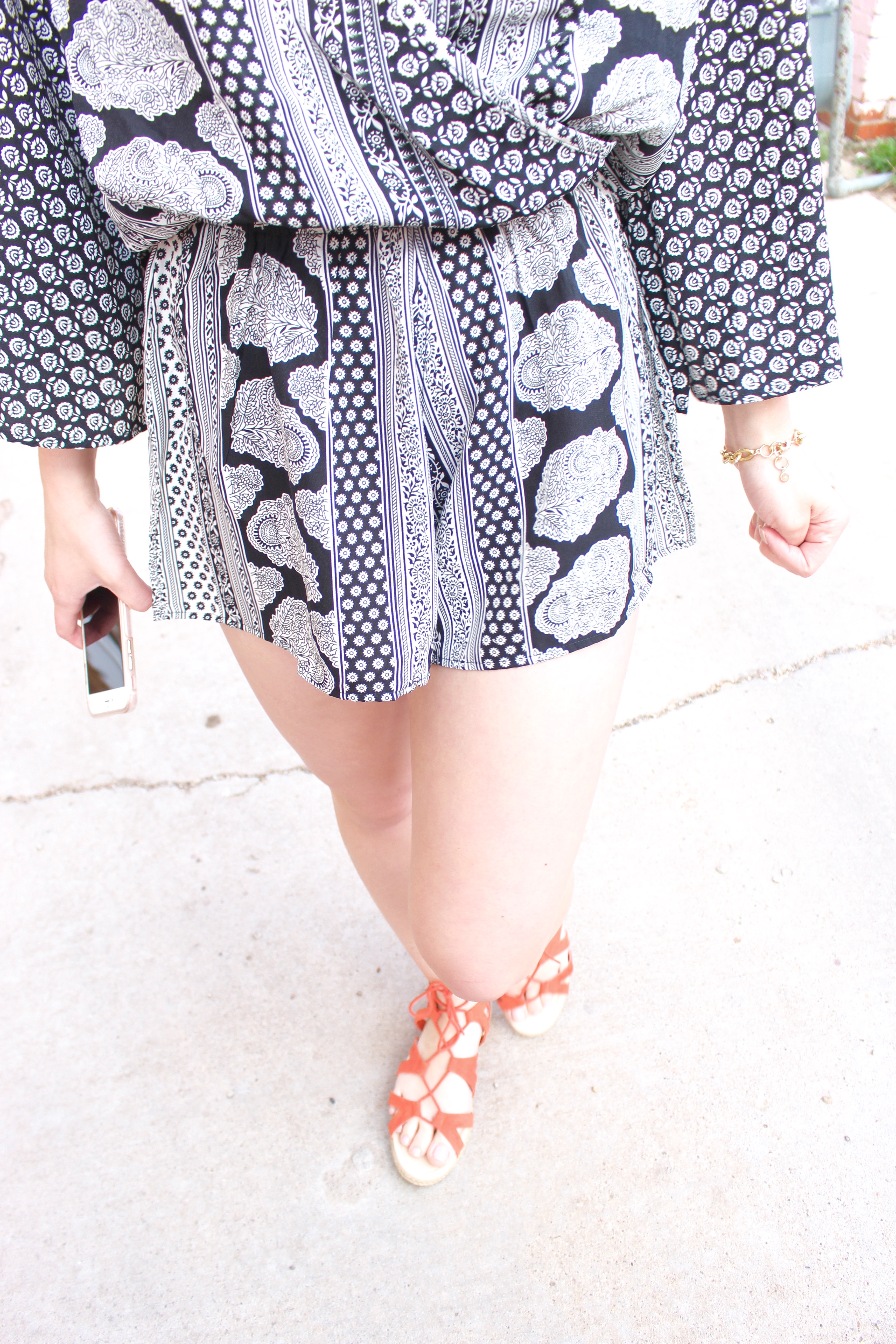 romper details with orange shoes