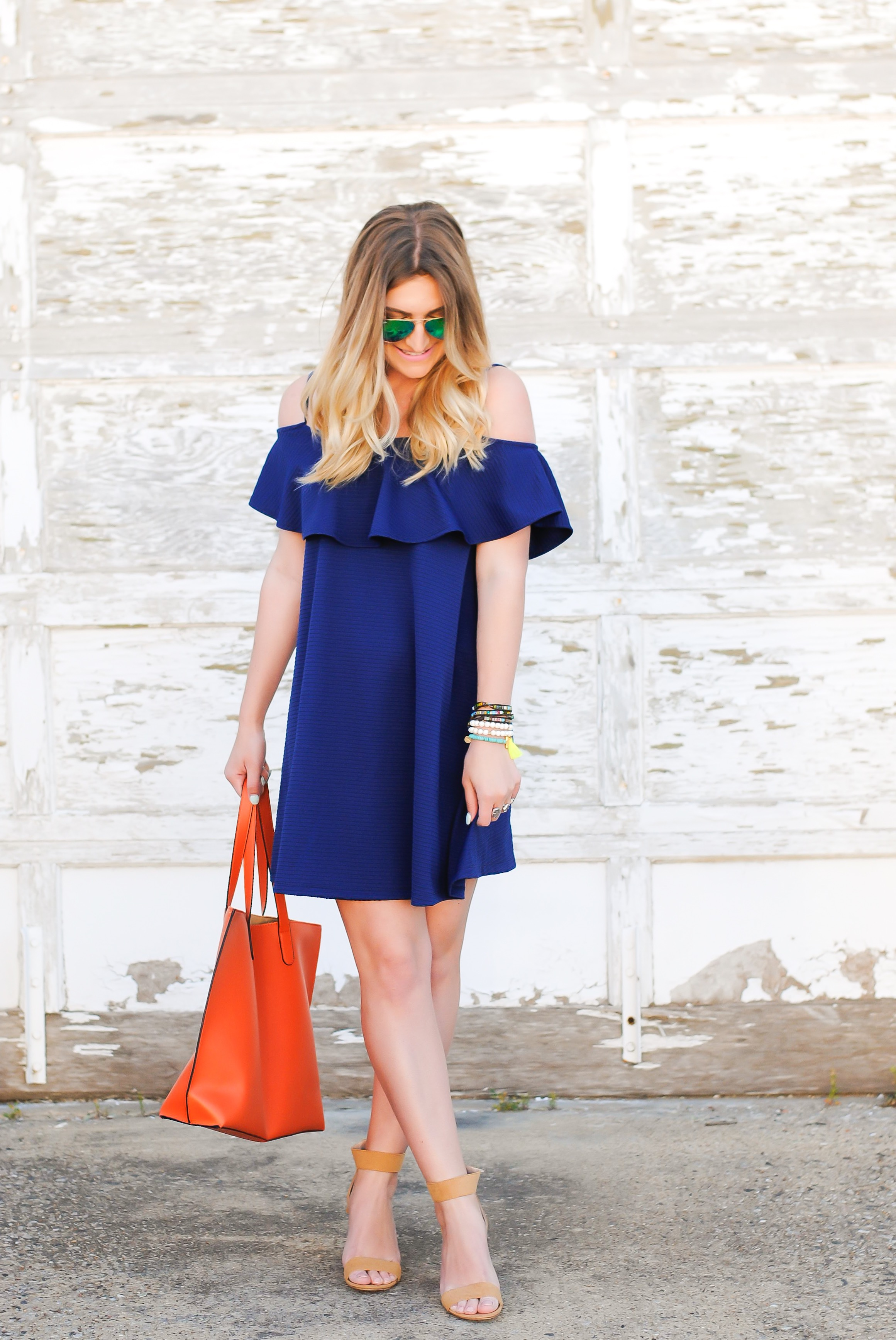 full body outfit in blue with an orange bag