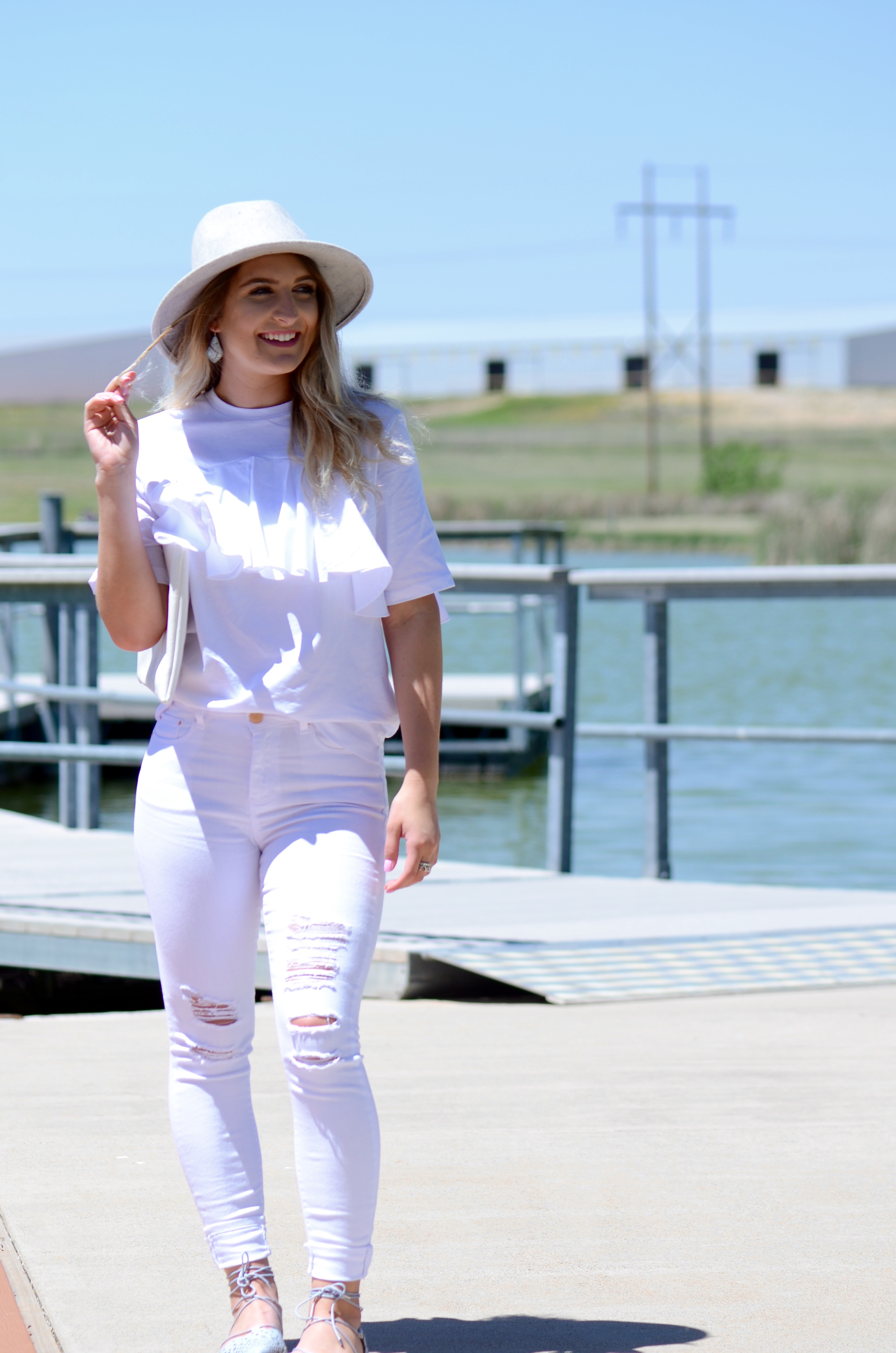 all white and a hat