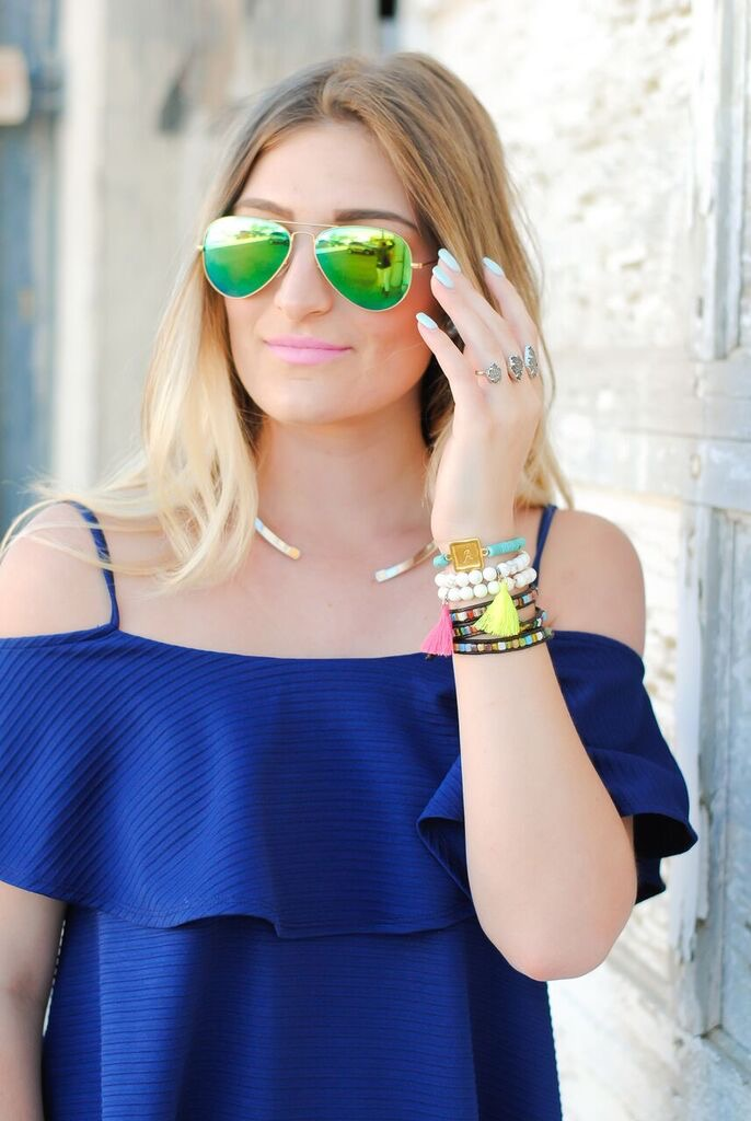 green ray bans and bracelet details