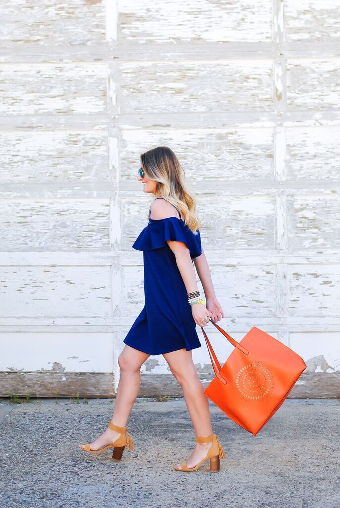 asos ruffled dress and bright orange bag