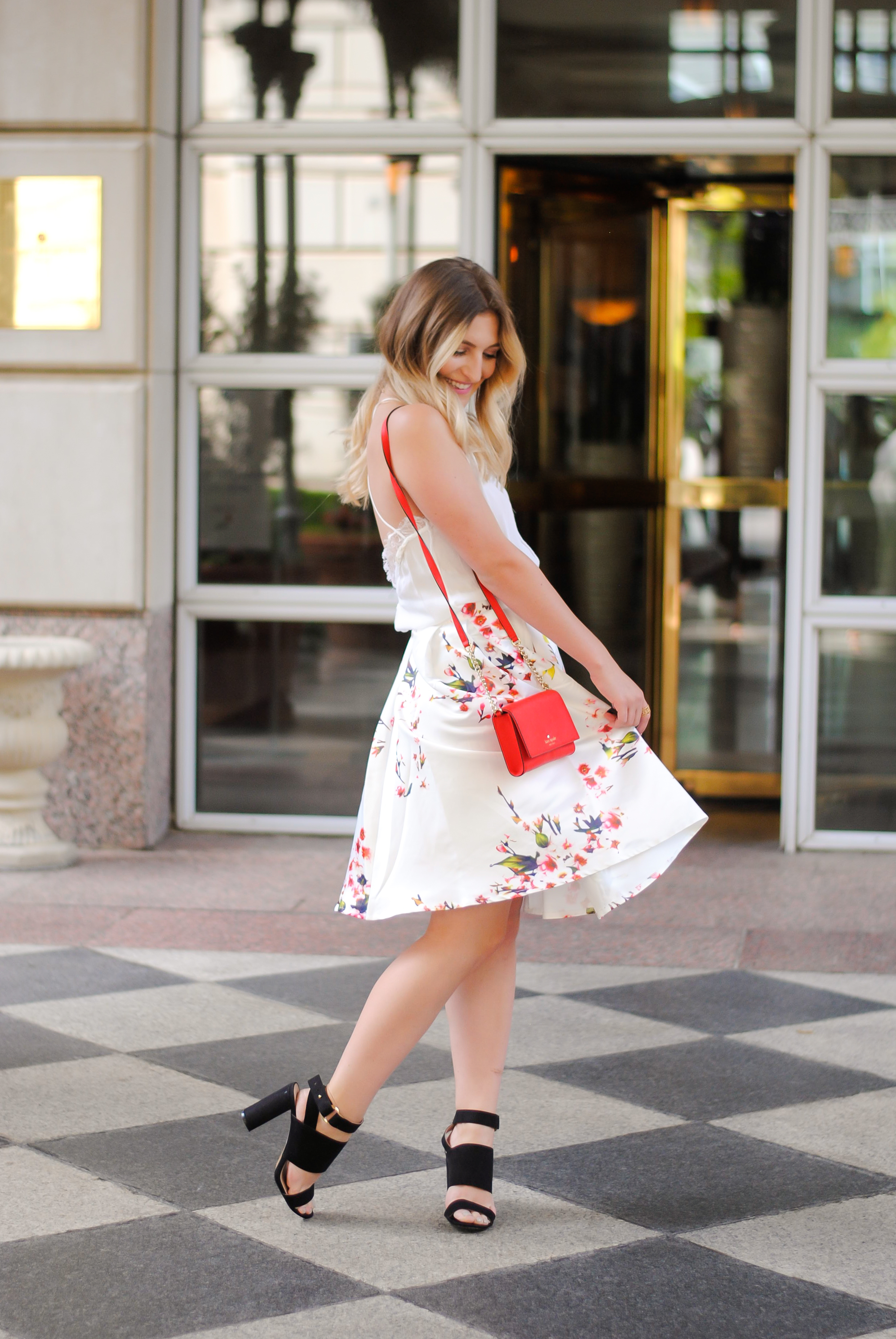 twirling in my floral midi skirt | Audrey Madison Stowe Blog