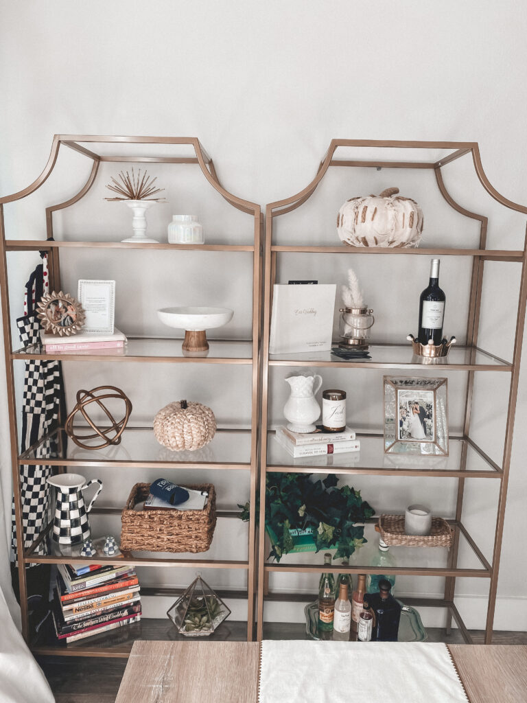 Gold Bookcases Decorated for Fall | Audrey Madison Stowe a fashion and lifestyle blogger